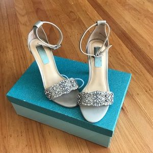 Betsy Johnson silver heels, size 5.